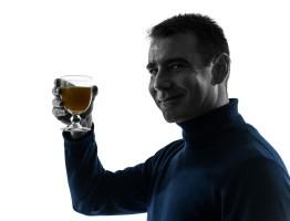 man drinking a beverage