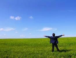 man breathing in a field